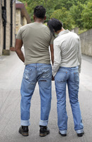 Back shot of a couple in jeans standing together