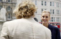 Popular : Back shot of a man talking to a woman