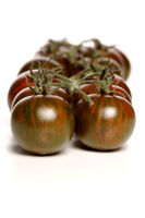 Black cherry tomatoes on white background