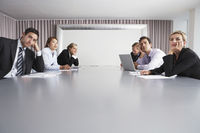 Bored businesspeople sitting in conference room