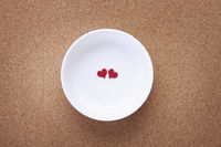 Bowl with two red heart shapes