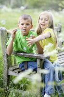 Boy and girl playing with soap bubbles
