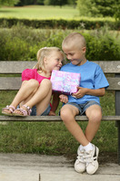 Boy giving a present to girl