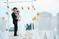 Bride and groom at their beach wedding ceremony