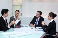 Business people in discussion at conference table