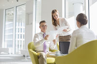 Business people working at office lobby