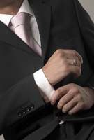 Popular : Businessman adjusting her sleeve