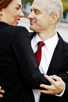 Businessman and businesswoman dancing together