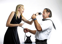 Businessman and businesswoman fighting over a phone