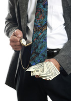 Popular : Businessman checking the time while holding cash in his hand