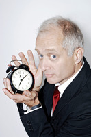 Popular : Businessman holding an alarm clock