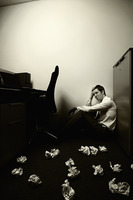 Popular : Businessman sitting and crying  crumpled papers scattered on the floor