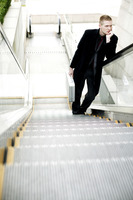 Popular : Businessman standing on the escalator thinking
