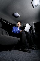 Businessman using laptop while sitting in the car