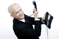 Popular : Businessman with a telephone hanging around his neck