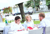 Popular : Businesspeople having food at outdoor restaurant