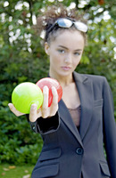 Popular : Businesswoman holding a green and a red ball