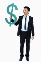 Popular : Cheerful businessman holding up a dollar sign