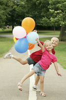 Children having fun with balloons