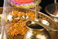 Close-up of religious offerings in a diwali pooja thali