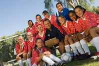 Coach with girls  soccer team  13-17