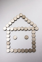 Coins making a house shape