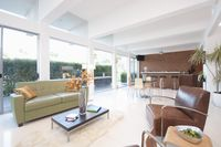 Contrasting coloured leather furniture in open plan living area