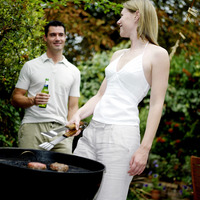 Popular : Couple grilling food in the park