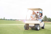 Popular : Couple looking at each other while sitting in golf cart against clear sky