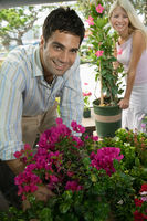 Couple selecting flowers at plant nursery portrait