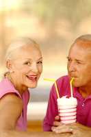 Couple sharing a glass of strawberry shake