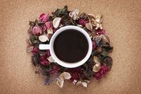Cup of coffee with dried flowers