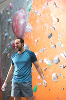 Popular : Dedicated man shouting by climbing wall in crossfit gym