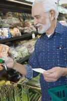 Elderly man shopping for vegetables