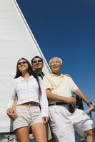 Family on sailboat smiling