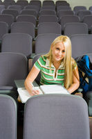 Female student sitting alone in lecture hall  portrait