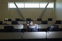 Female student working in computer classroom