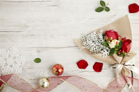 Flat of wooden background with roses