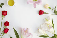 Flatlay of white background with flowers