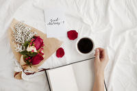 Flatlay of white cloth background with bouquet roses