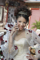 Girl  13-15  using mobile phone at quinceanera portrait