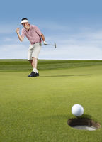 Popular : Golfer cheering after putting
