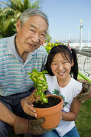 Grandfather and granddaughter gardening  portrait