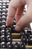 Hand on abacus