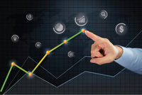 Hand pointing towards business growth point on line chart concept