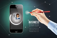 Hand presenting business strategy on smartphone with stylus concept