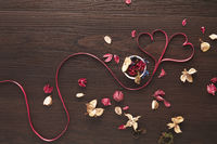 Heart shaped ribbon with dried flowers design