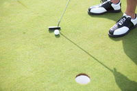 Popular : High angle view of man playing golf