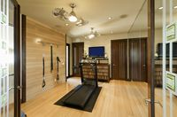 Interior with gym equipment and wooden floor