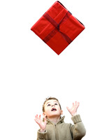 Little boy tossing his gift